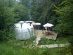 Getting the wood burning stove going at Sapperton yurt glade